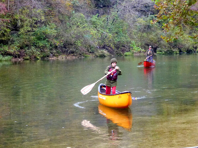 Sam and Gabe standing and paddling whitewater solos